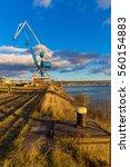 crane in harbour on river...   Shutterstock . vector #560154883