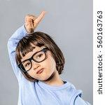 unsure beautiful little child... | Shutterstock . vector #560163763