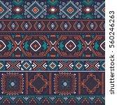 dark multicolor tribal vector... | Shutterstock .eps vector #560246263