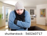 male in winter clothes inside... | Shutterstock . vector #560260717