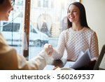 female agent greeting new... | Shutterstock . vector #560269537