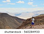 traveler with a beautiful view... | Shutterstock . vector #560284933