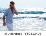 man on the beach | Shutterstock . vector #560313403