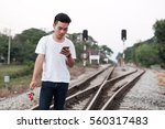 young casual man use mobile... | Shutterstock . vector #560317483