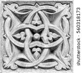 Small photo of abstract ornament, a stone bas-relief on the wall
