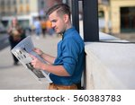 young man reading the newspaper ... | Shutterstock . vector #560383783