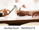 closeup of hands of business... | Shutterstock . vector #560396173
