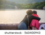 mother and daughter hugging... | Shutterstock . vector #560400943