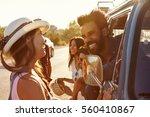 friends on a road trip make a...   Shutterstock . vector #560410867
