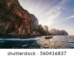 a small boat at dawn. thai boat | Shutterstock . vector #560416837