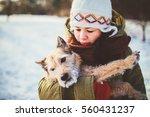 girl and her dog big love best... | Shutterstock . vector #560431237