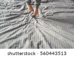 a child jumping on the bed.... | Shutterstock . vector #560443513