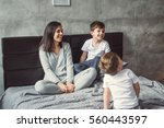 mother and two sons playing in... | Shutterstock . vector #560443597