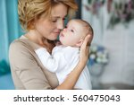 young mother holding her... | Shutterstock . vector #560475043