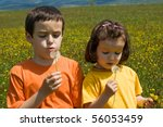 two children blowing dandelion... | Shutterstock . vector #56053459