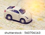 closeup car toy on the map  ... | Shutterstock . vector #560706163