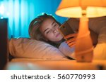 the young woman lay on the bed... | Shutterstock . vector #560770993
