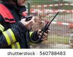 firefighter used a walkie... | Shutterstock . vector #560788483
