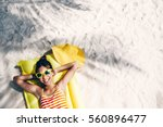 child girl in yellow swimwear... | Shutterstock . vector #560896477