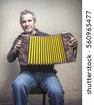 Small photo of old man playing accordion