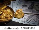 nugget gold and dollar bills ... | Shutterstock . vector #560980333