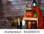 halloween pumpkin  candles and... | Shutterstock . vector #561000373