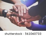 diverse group of people joining ... | Shutterstock . vector #561060733