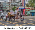 Small photo of Luodong, Taiwan - October 18, 2016: Taiwanese man carrying different items on a three-wheeled bicycle. Tricycles are very popular means of transportation for older people in Taiwan