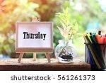 thursday   concept of canvas... | Shutterstock . vector #561261373