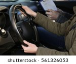 young woman passing driving... | Shutterstock . vector #561326053