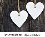 decorative white wooden hearts... | Shutterstock . vector #561335323