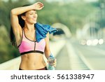 beautiful young woman running... | Shutterstock . vector #561338947