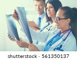 young group of doctors looking... | Shutterstock . vector #561350137