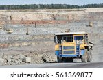 Huge Dump Truck Transporting...
