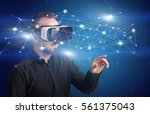 amazed businessman with virtual ... | Shutterstock . vector #561375043