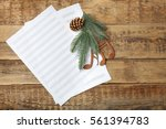 Small photo of Christmas musical composition on wooden background