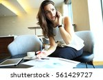 business woman working in... | Shutterstock . vector #561429727