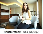 businesswoman drinking coffee... | Shutterstock . vector #561430357
