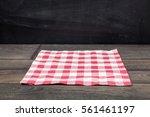 red napkin  on dark wooden... | Shutterstock . vector #561461197