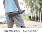 man holding rusty machete. | Shutterstock . vector #561461587