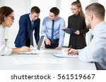 group of business people at a... | Shutterstock . vector #561519667