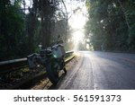 motorbike on the road riding... | Shutterstock . vector #561591373