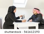 muslim arabic couple at home | Shutterstock . vector #561612193
