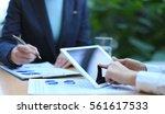 business adviser analyzing... | Shutterstock . vector #561617533