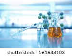 syringe with vial and orange... | Shutterstock . vector #561633103