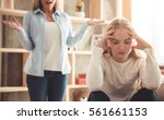 beautiful woman is scolding her ... | Shutterstock . vector #561661153
