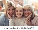 three generations of women.... | Shutterstock . vector #561676993