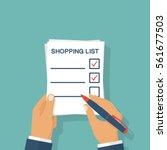 man hands holding paper sheet... | Shutterstock .eps vector #561677503