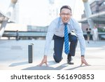 young asian businessman... | Shutterstock . vector #561690853