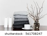 pile of grey knitted sweaters... | Shutterstock . vector #561708247